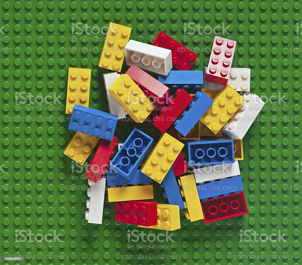 Pile of Lego Block Bricks on Green Baseplate