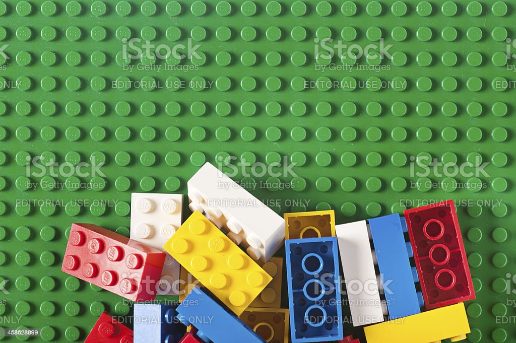 Pile of Lego Blocks and Bricks on Green Baseplate royalty-free stock photo