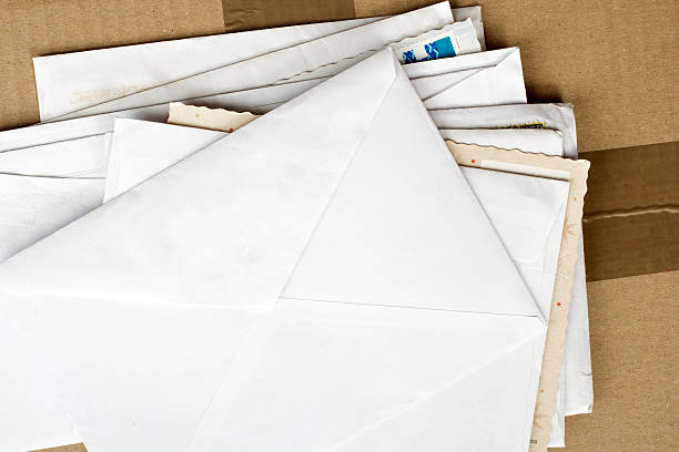 pile of letters and postal parcel - mail stock photos and pictures