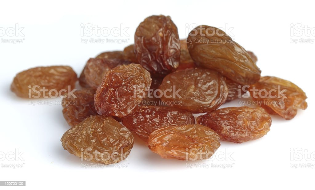 A pile of light colored raisins stock photo