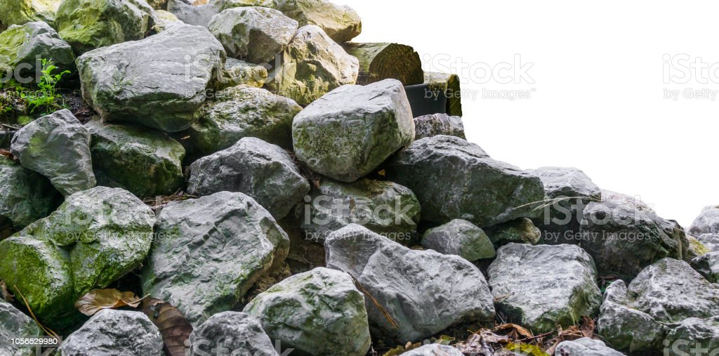 Pile of lime stone rocks in close up isolated on a white background...
