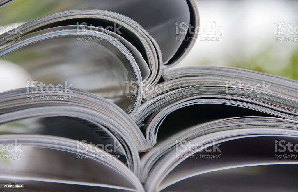 Pile of Magazines on Table stock photo