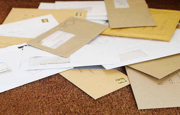 pile of mail on doormat - mail stock photos and pictures
