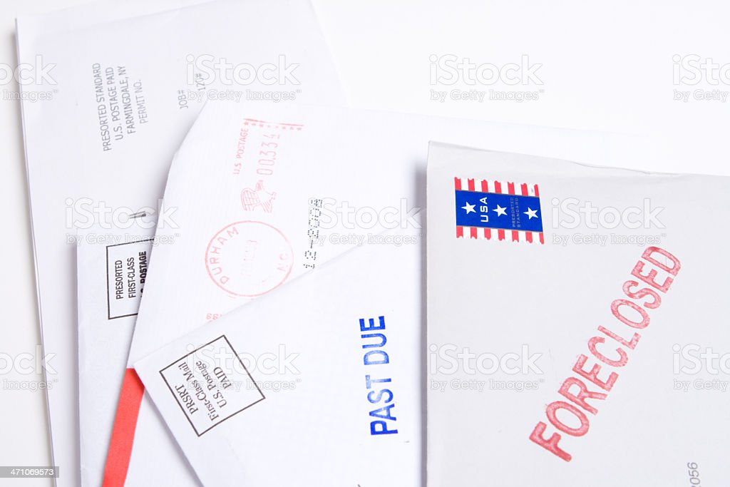 "Pile of Mail Stamped ""FORECLOSED"" and ""PAST DUE"", Isolated Background royalty-free stock photo"