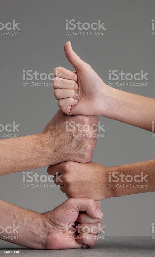 pile of male and female fists giving thumbs up royalty-free stock photo