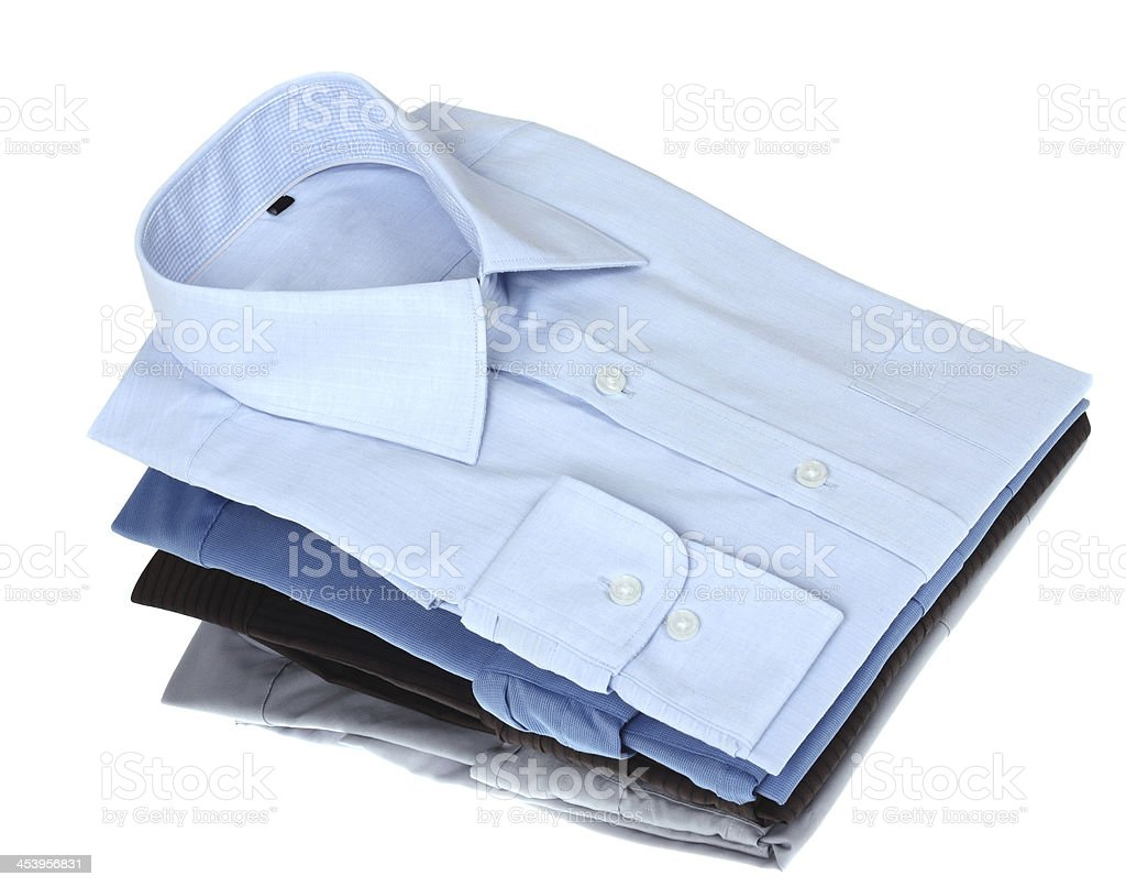 Pile of man's shirts stock photo