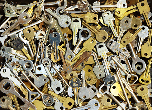 Pile Of Many Different Yellow And White Old Metal Keys Stock Photo - Download Image Now
