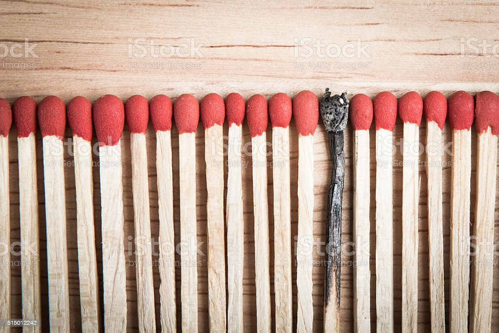 pile of match arrange in a row stock photo