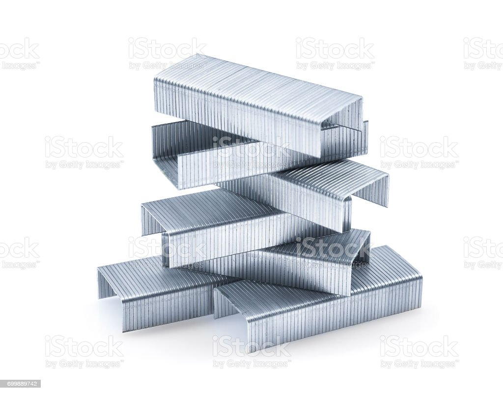 pile of metal staples isolated on white background stock photo