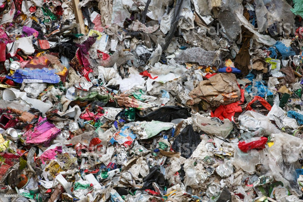 Pile of mixed waste at the dumpsite storage stock photo