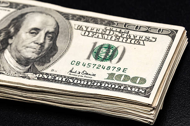 pile of money - money black background stock photos and pictures