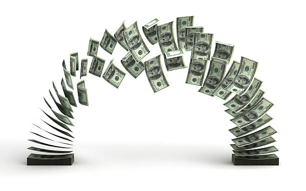 Pile of money transferring to another pile stock photo