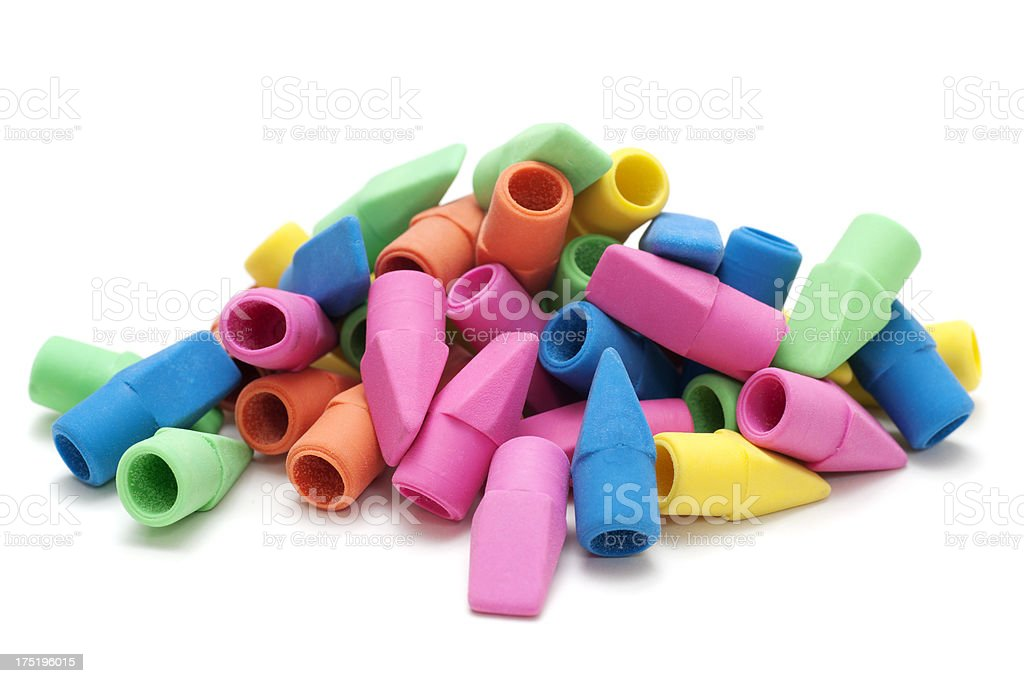 Pile of multi-color pencil erasers isolated on white.
