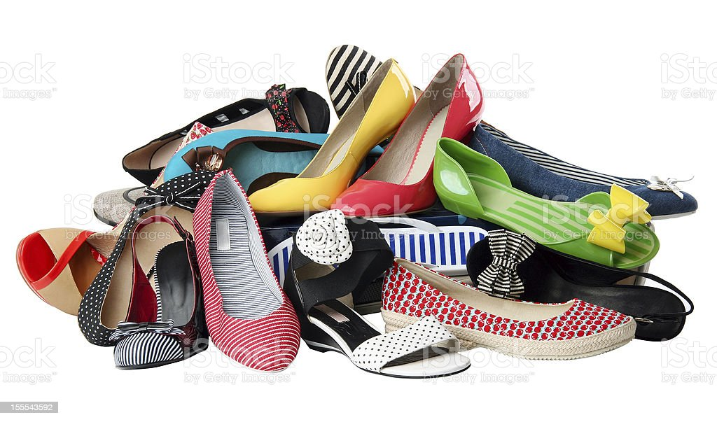 A pile of multi-colored and patterned women's shoes stock photo
