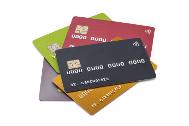 Pile of multicolored credit cards on white background, black card on top stock photo