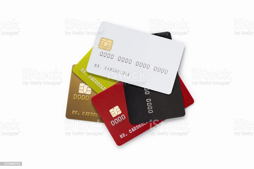 Pile of multicolored credit cards on white background stock photo