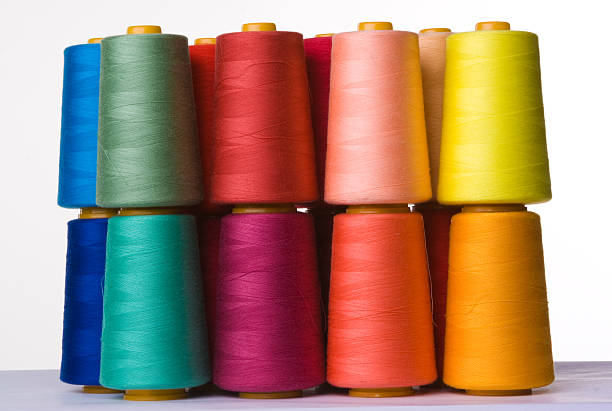 A pile of multicolored spools of sewing thread spools of sewing threads spool stock pictures, royalty-free photos & images