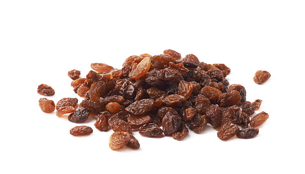 pile of multiple raisins isolated - grape sugar stock-fotos und bilder