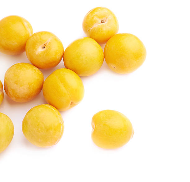 pile of multiple yellow plums isolated - mirabelle photos et images de collection
