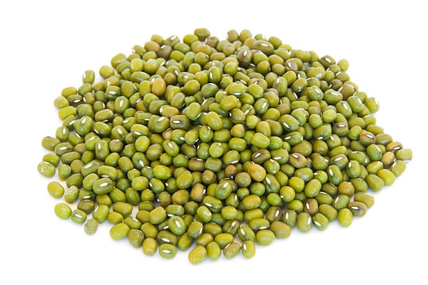 Pile of mung beans on white stock photo