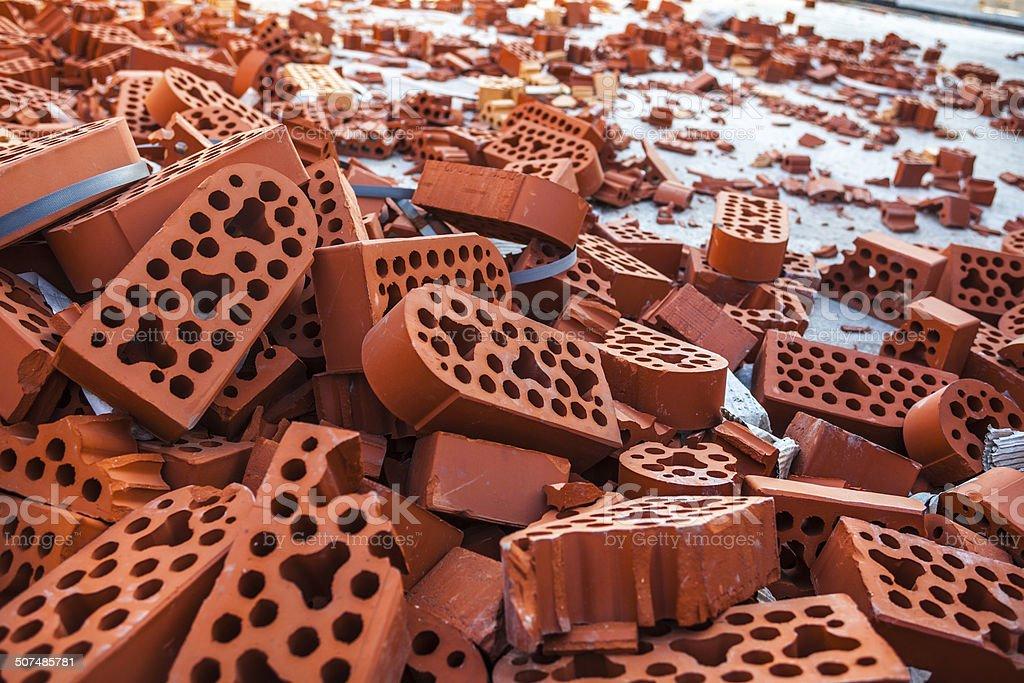 Pile of new intact and beaten bricks stock photo