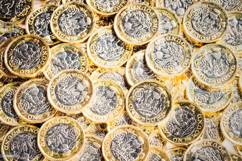 Pile of new UK One Pound Coins stock photo