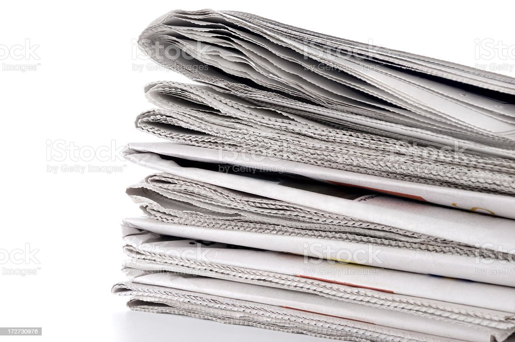 Pile of Newspapers Against a White Background royalty-free stock photo