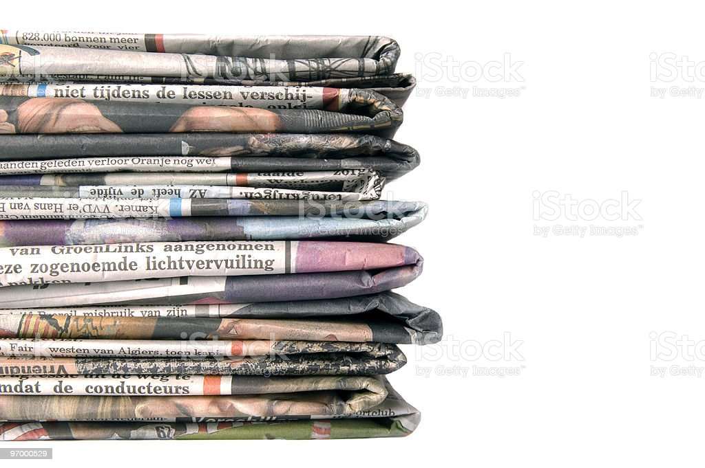 Pile of newspapers on a white background royalty-free stock photo