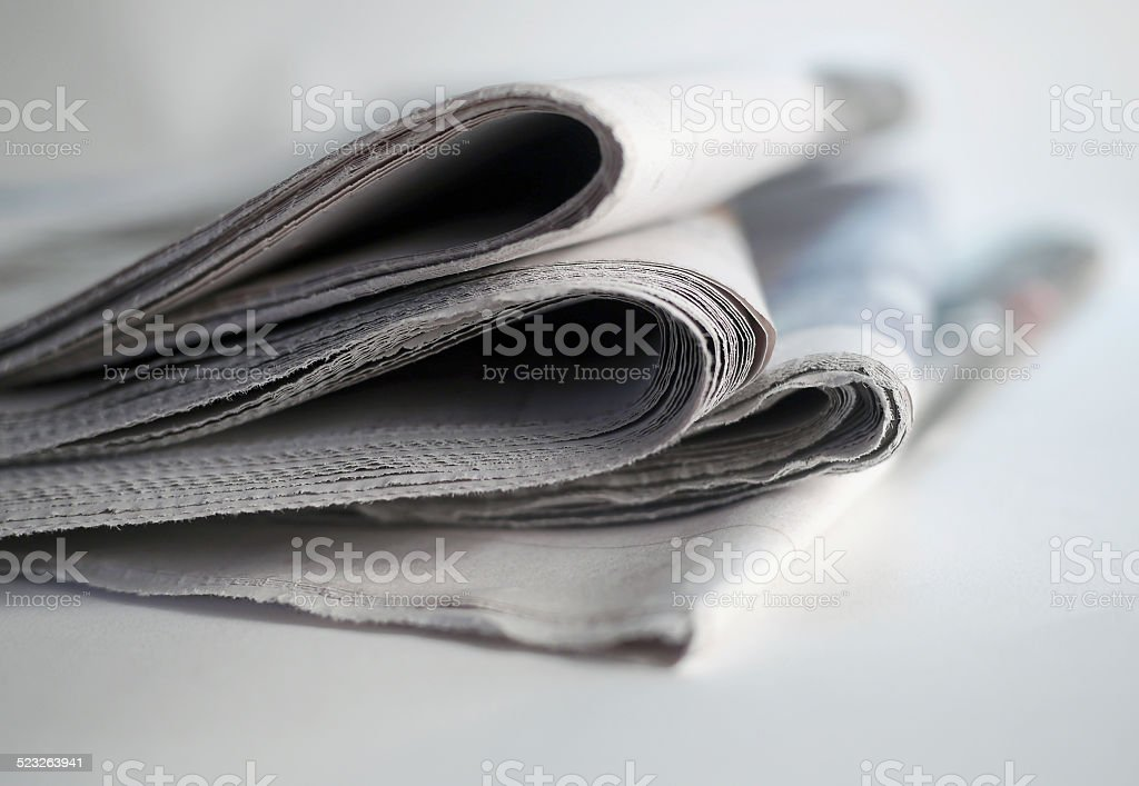 pile of newspapers stock photo