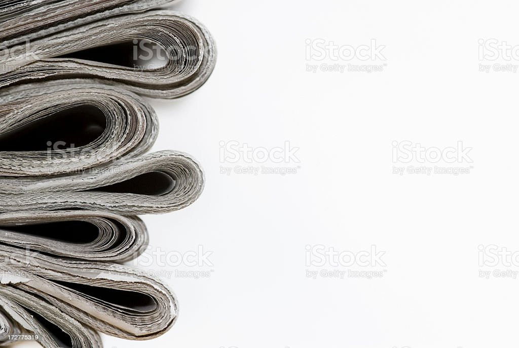 Pile of Newspapers Profile View royalty-free stock photo