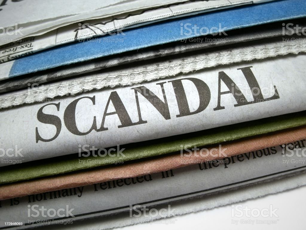 Pile of newspapers with scandal headline prominent royalty-free stock photo