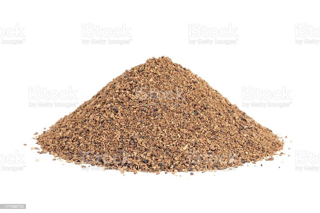 Pile of Nutmeg powder (Myristica fragrans) isolated on white stock photo