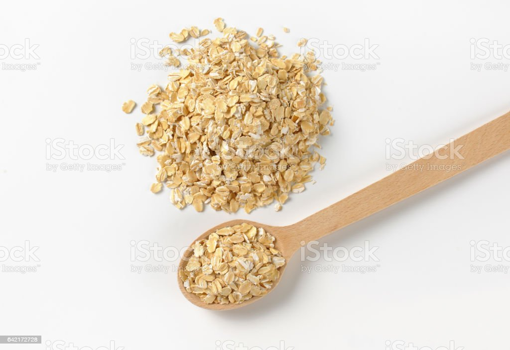 pile of oat flakes stock photo