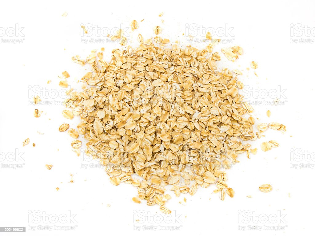 Pile of oatmeal isolated on white background stock photo