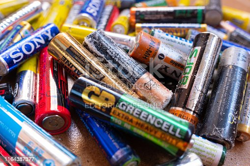 Valencia, Spain- July 24, 2019: Pile of old and used AA and AAA batteries, damaged and broken by acid, ready to send a clean recycling point.