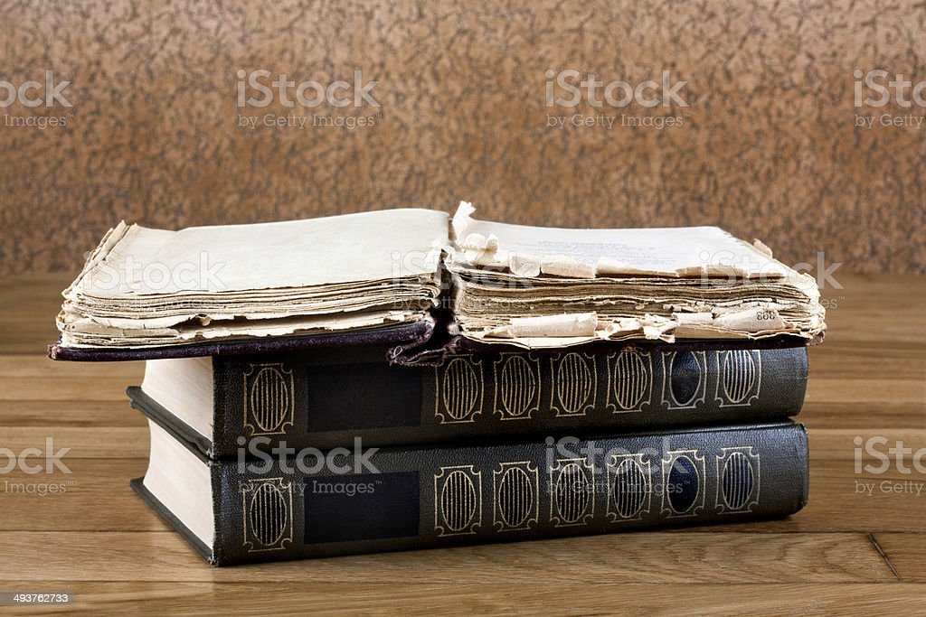 Pile of old books on a beautiful wooden table royalty-free stock photo