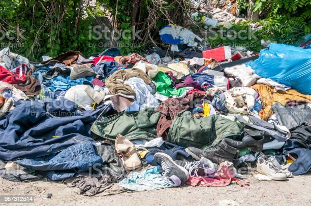 Pile of old clothes and shoes dumped on the grass as junk and garbage picture id957312514?b=1&k=6&m=957312514&s=612x612&h=njx8zsvr0vcewmx4lhl4q3wd0owgv6lufsyp4iv80xa=