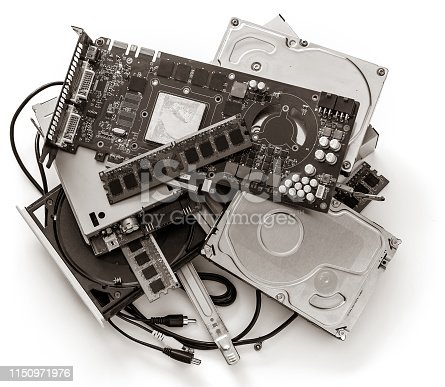 A bunch of old computer devices. Photo monochrome. Old technology. Isolated on white.