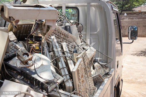 pile of old computer waste in the truck in the way to the junkyard
