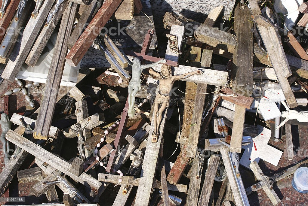 Pile of old crucifixes stock photo