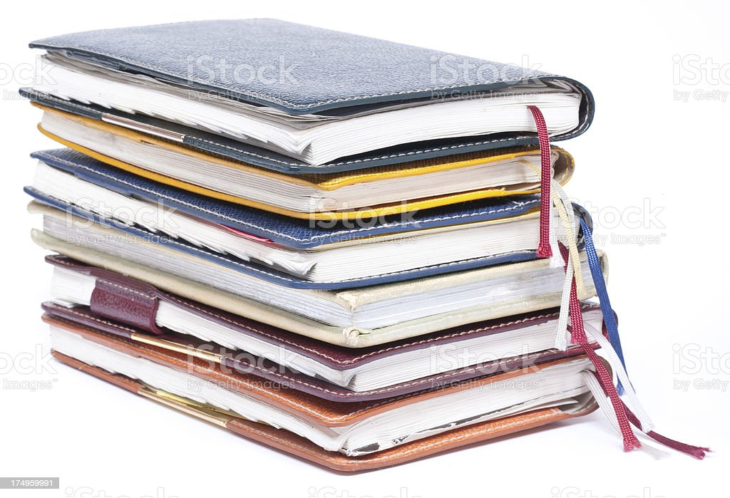 Pile of old diaries isolated royalty-free stock photo