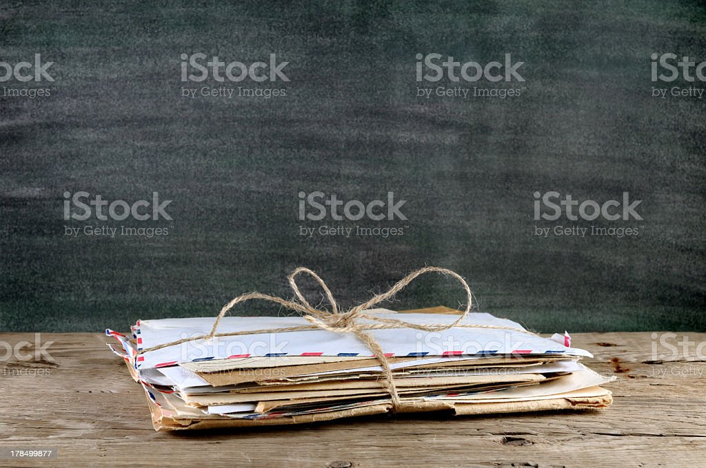 A pile of old envelopes and twine holding them together stock photo
