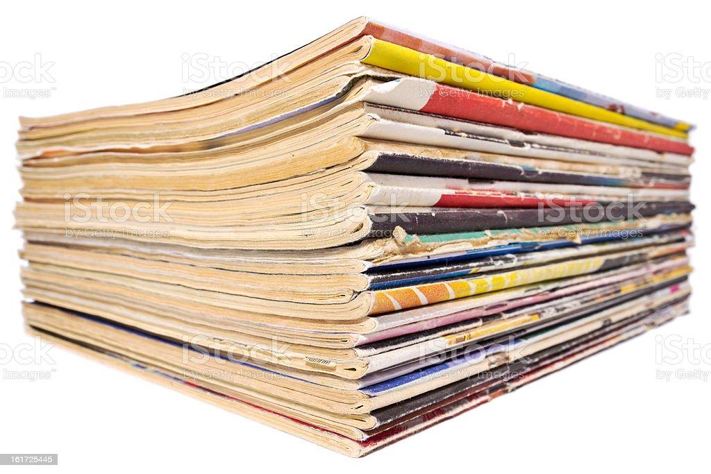 Pile of old magazines isolated on white background royalty-free stock photo
