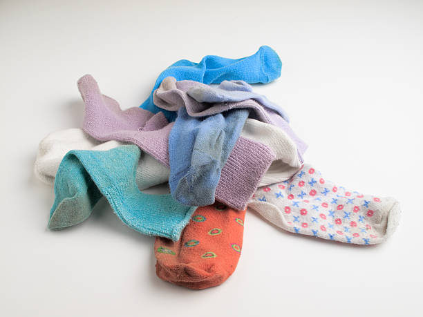 Pile of old mismatched socks stock photo