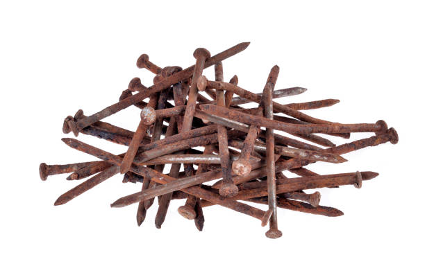 A pile of old nails A pile of old nails on a white background hank aaron stock pictures, royalty-free photos & images
