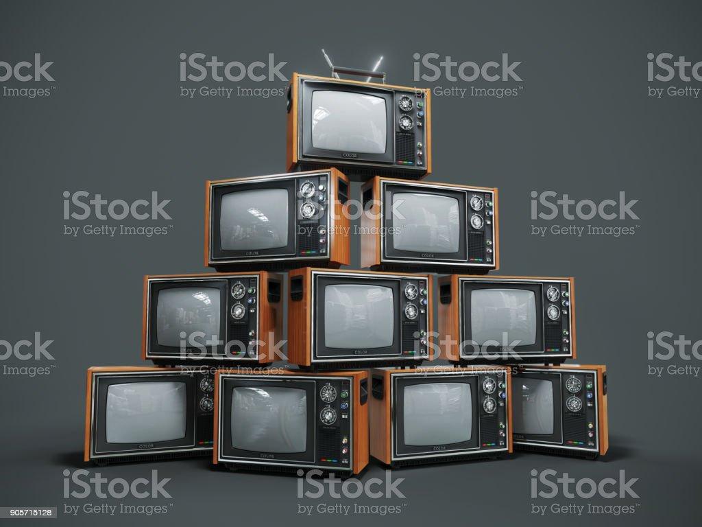 Pile of old retro TVs on dark background stock photo