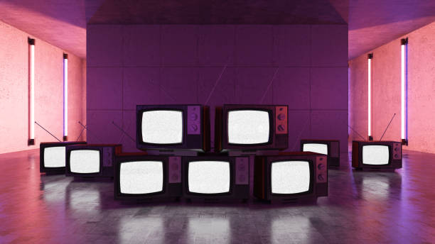 Pile of Old Televisions with Neon Lights stock photo