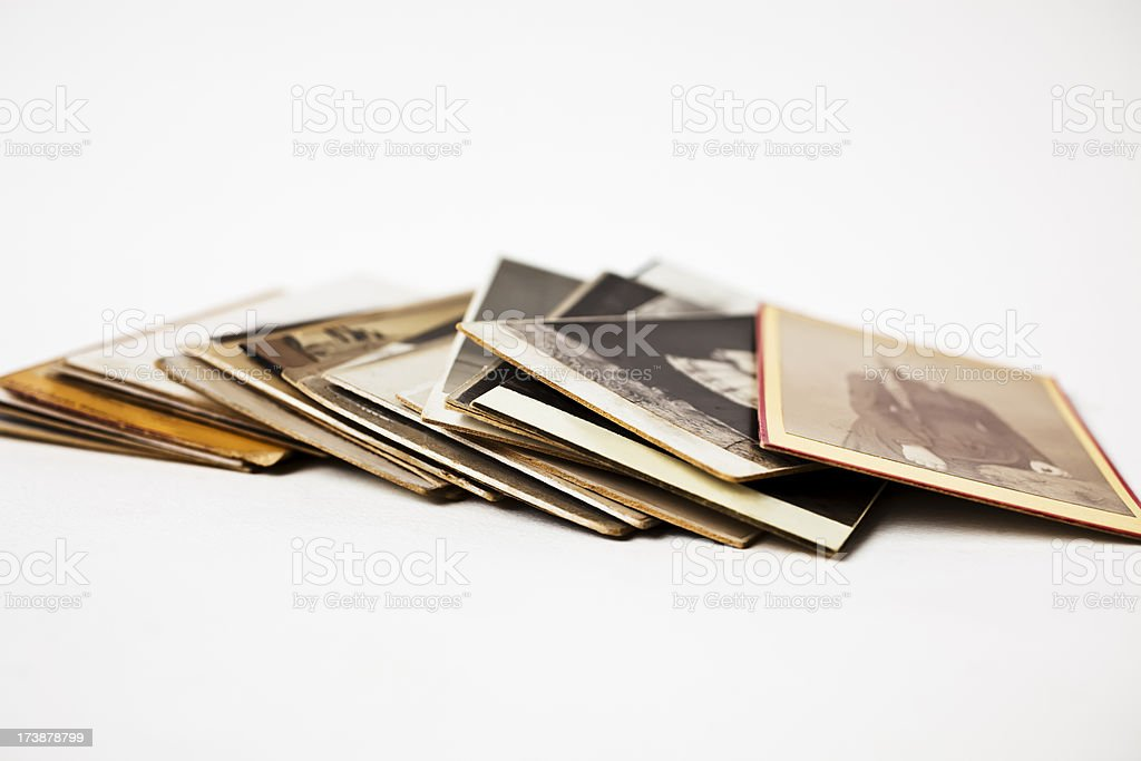 Pile of old  worn family photographs on white background. royalty-free stock photo