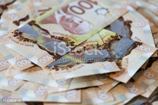 large pile of Canadian one hundred dollar bills