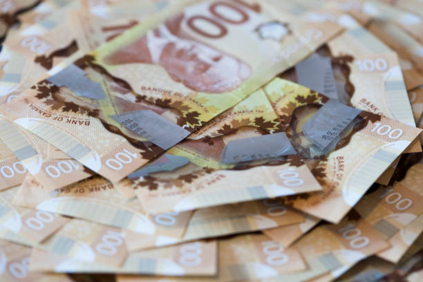 Pile of One Hundred Canadian Dollar Bills stock photo